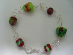 bracelet of handmade lampwork beads with sterling silver